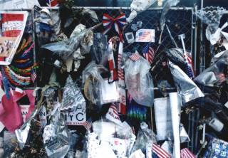 Photo by Duane Ruth-Heffelbower of remembrances left on the fence surrounding ground zero in NYC January 2002. - jpg - 20762 Bytes